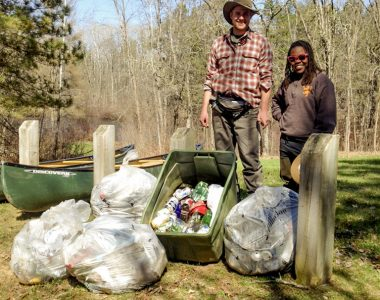Volunteers with trash from campsite cleanup