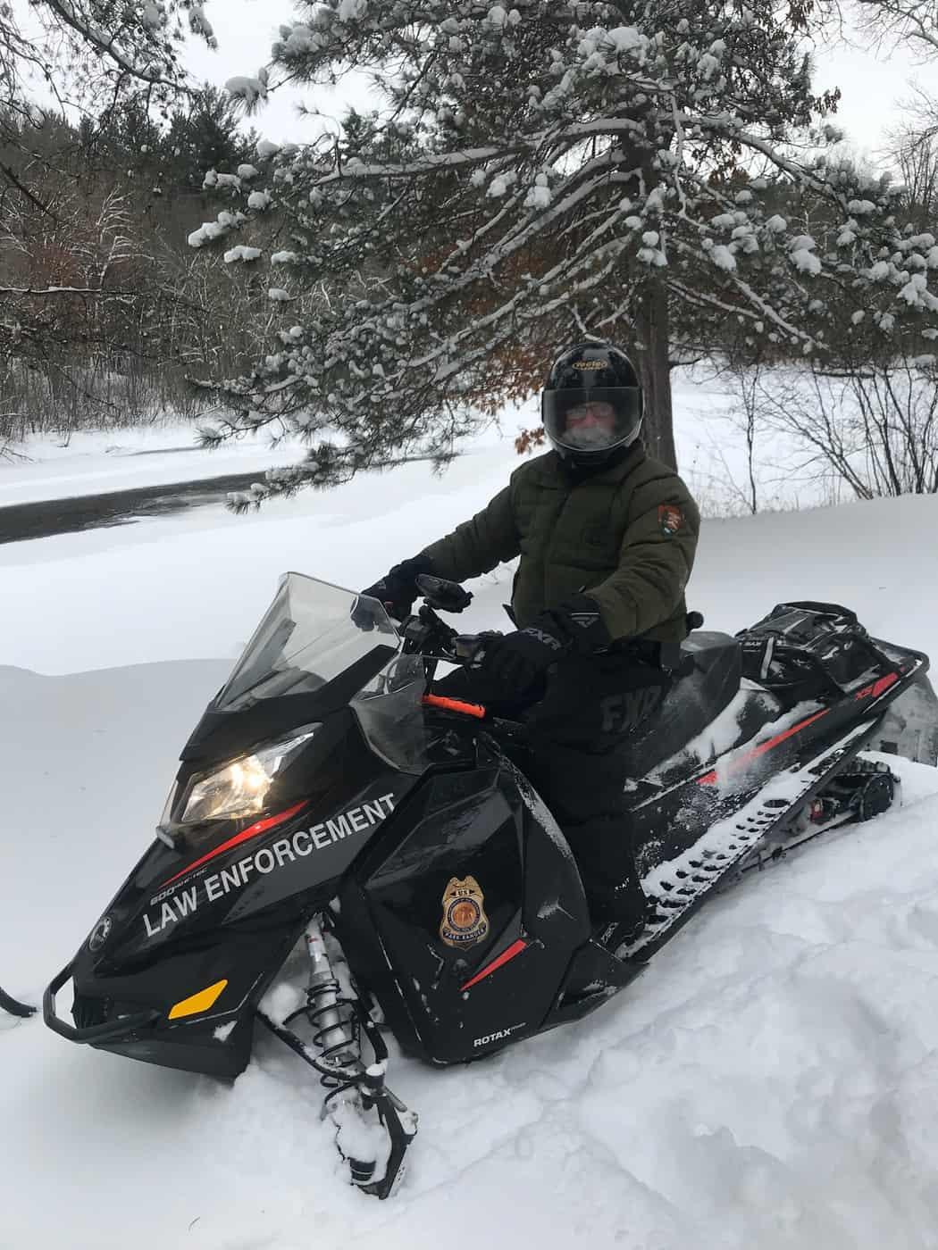 U.S. Park Ranger Charlie on snowmobile patrol. (Photo: NPS)