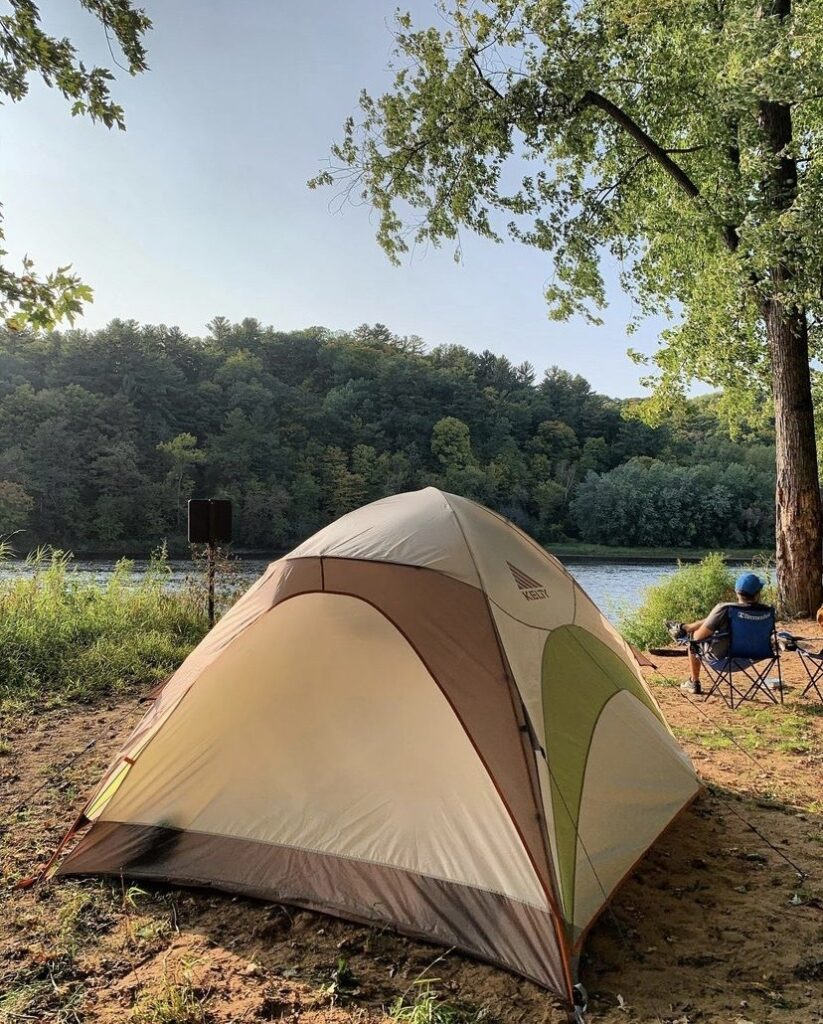 A camping tent set up on the sandy bank of the St. Croix River. Photo by Kate Wright.