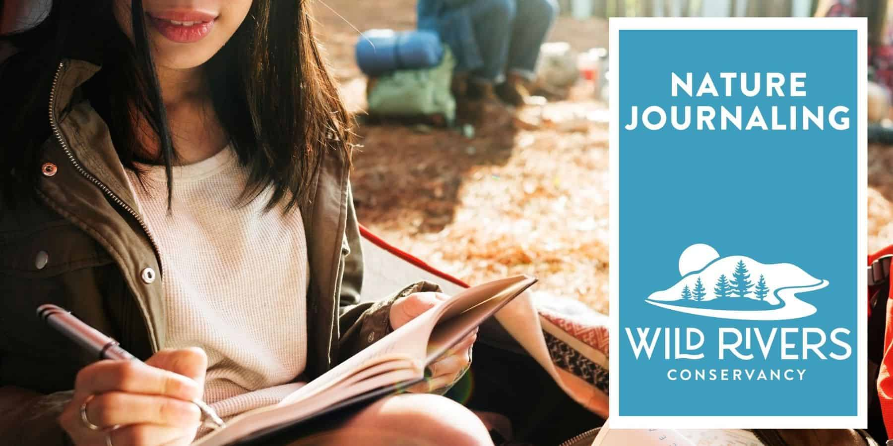 Girl writing in journal sitting in the outdoors